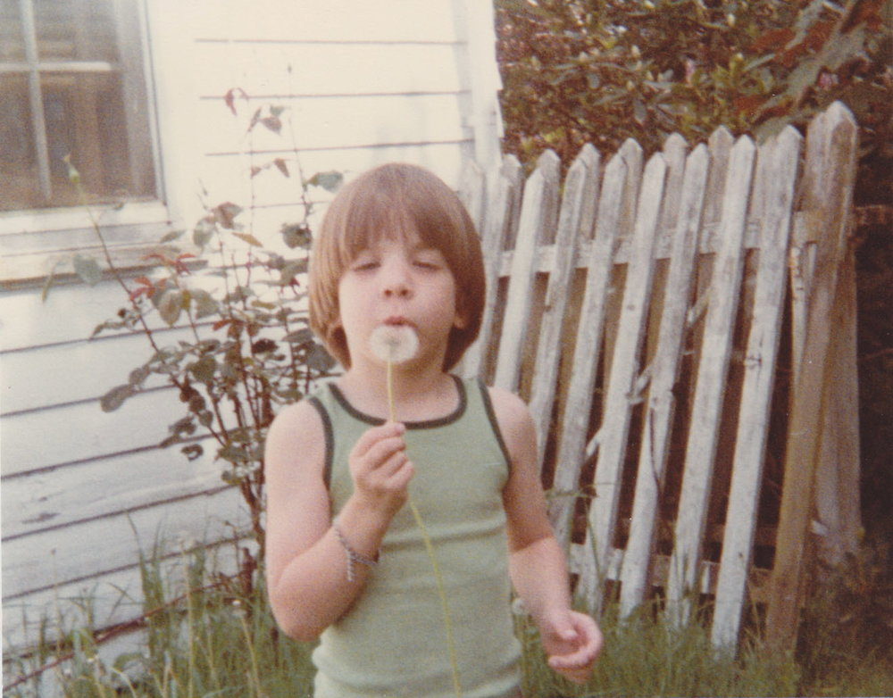 Me in my backyard spreading seeds of dandilions i'd be weeding for years to come