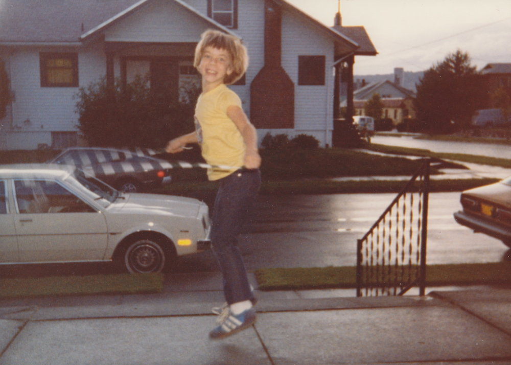 Me jump roping in front my grandparent's home at 24th and Se caruthers