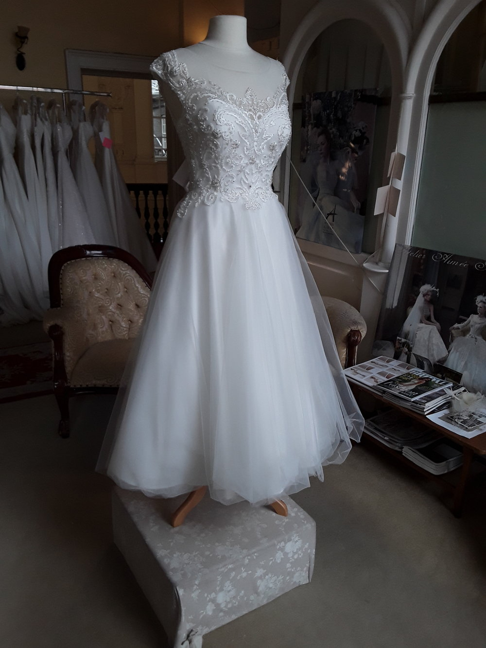 WHITE ROSE T LENGTH, TULLE DRESS WITH EMBELISHED BODICE  COLOUR: IVORY  SIZE: 12  WAS €1,295 NOW €799  REF: E122/ALISON