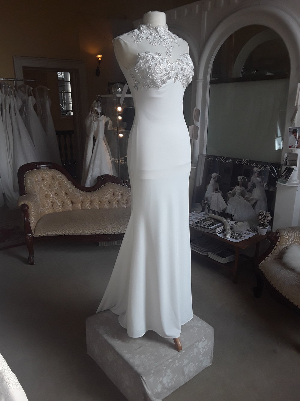 GINO CERRUTI CHIFFON MERMAID DRESS WITH EMBELISHED NECK DETAIL  COLOUR: IVORY  SIZE: MEDIUM (8/10)  WAS €995 NOW €€550  REF: E125