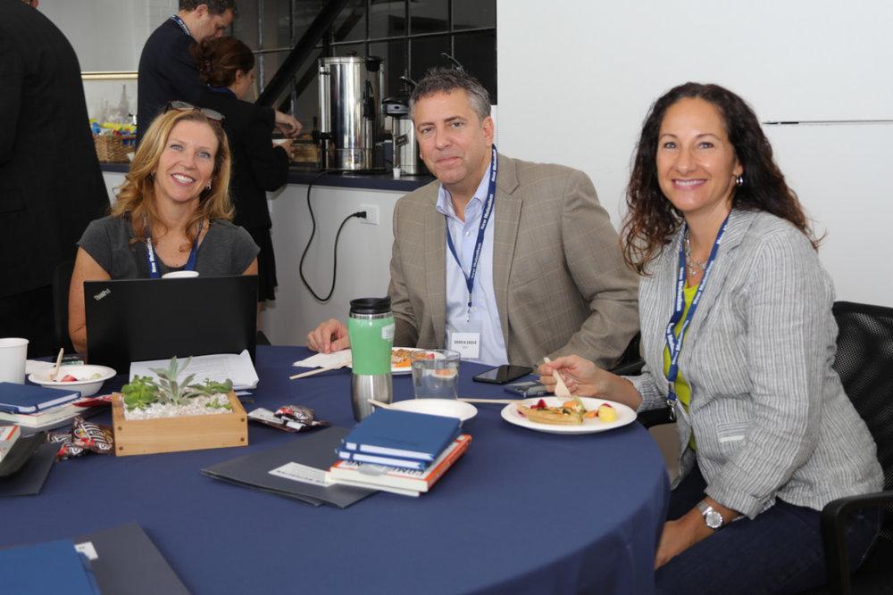 The F.B. Heron Foundation team members, including the President,    Dana Bezerra     (left)