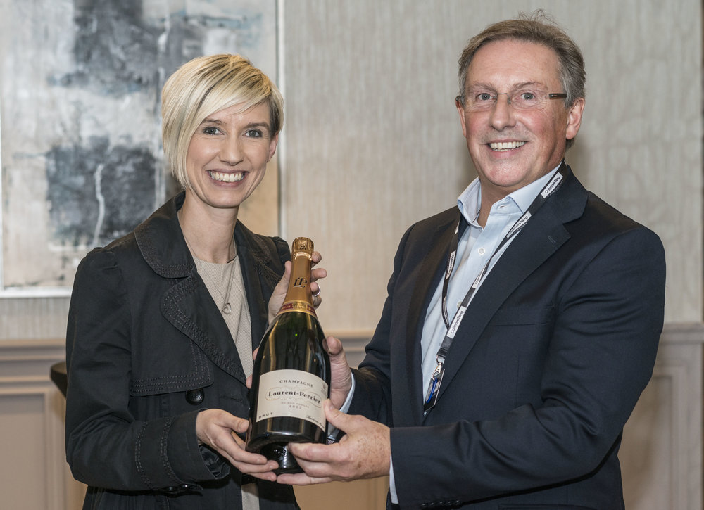 Donna Bruce (Northern Lights) wins the champagne raffle (with Andy Robinson Group CEO).JPG