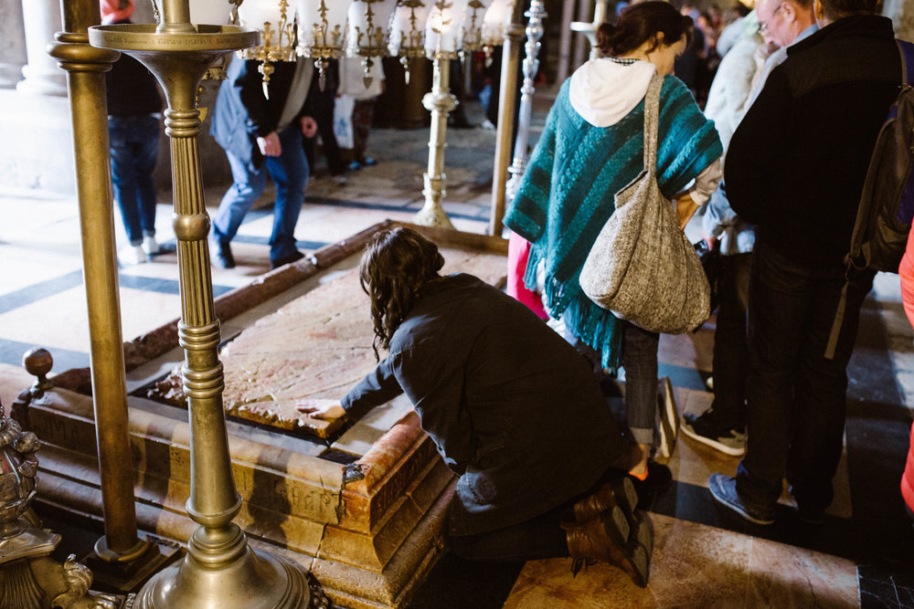 Praying on the slab that Jesus's body was prepared for burial