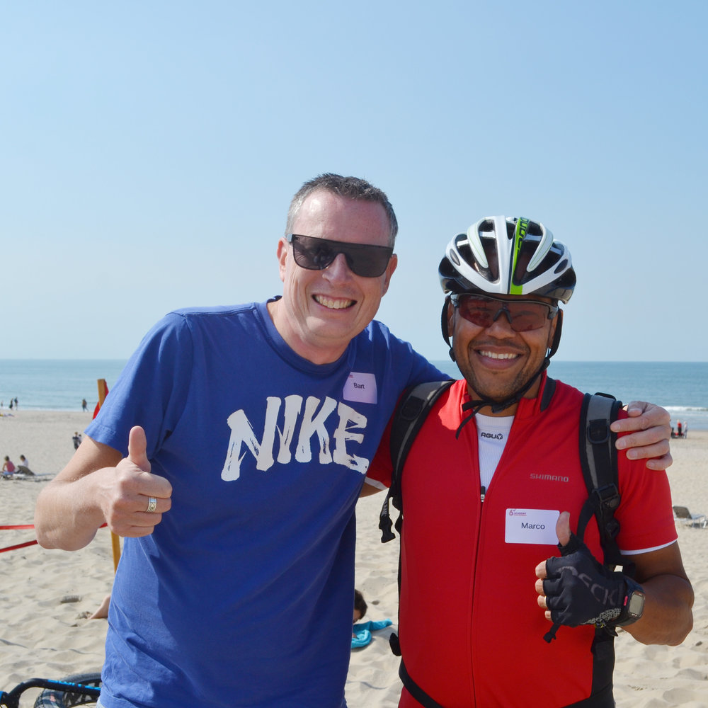 Beach-biking satisfaction between Marco and Bart, one of our partners