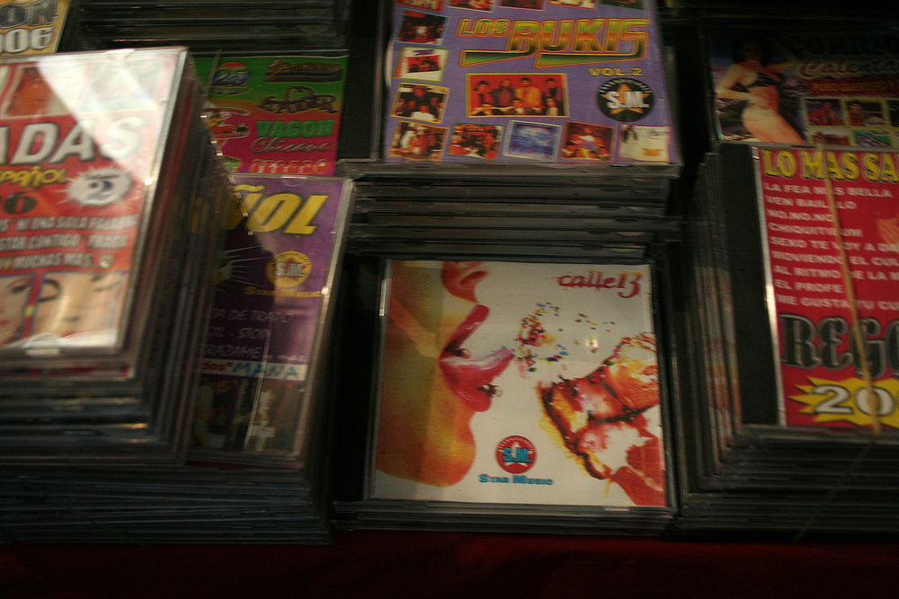 Narcocorrido or narco ballad CDs sold in plazas is a subgenre of the Mexican norteño-corrido (northern ballad) music genre. Much of the music celebrates narco culture.