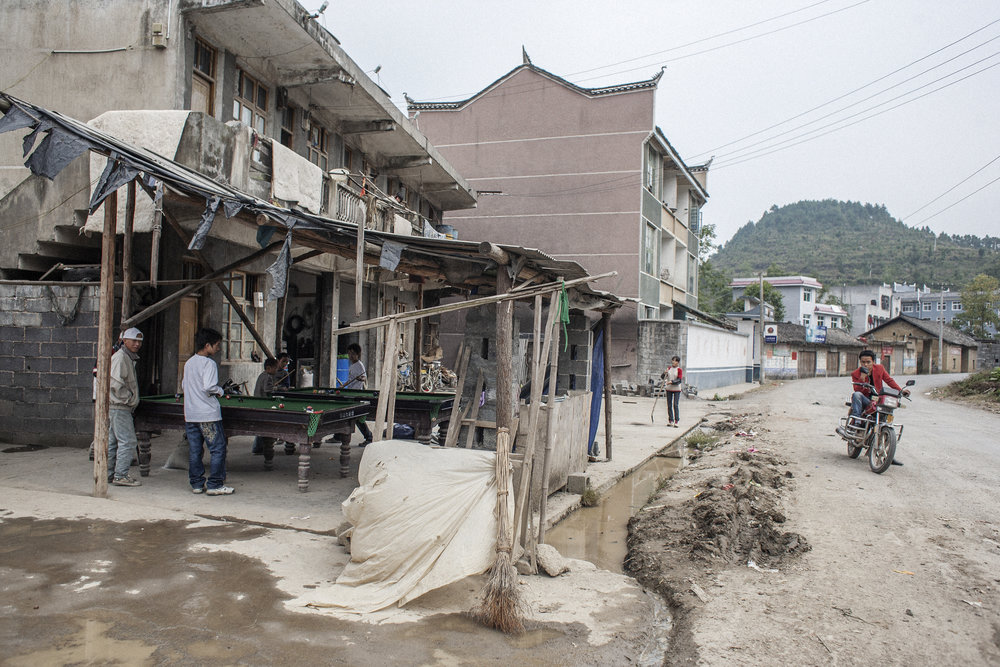 Outside of the small villages many Miao have begun to migrate away from their ancestral lands. Once in the urban center they continue on to China's rapidly growing mega cities.