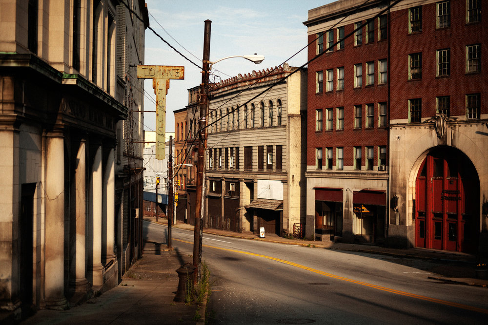 Brownsville, PA   Of all the towns I photographed I thought that Brownsville was the most elegant and desolate (it's home to a lovely and ornate train station, far right, that is now crumbling) which made it all the more sad because it made me think of what our national priorities are. It's inconceivable that we spend trillions on wars and billions bailing out Wall Street but that these important parts of our country and ultimately individuality are just left to rot.