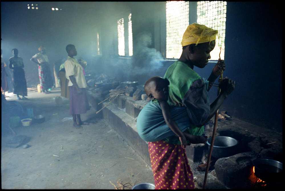 A mother with her newborn child at a hospital kitchen in Sierra Leone.