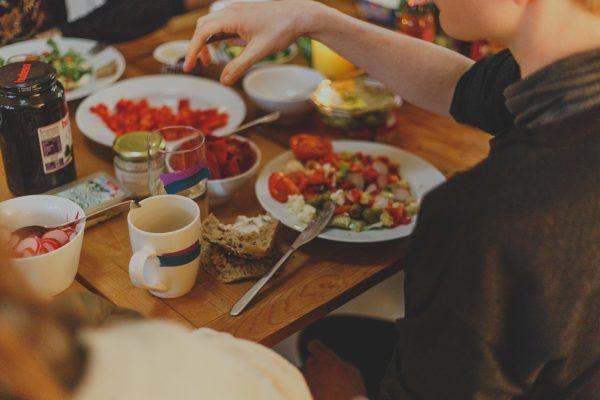 man-sitting-at-table-eating.jpg