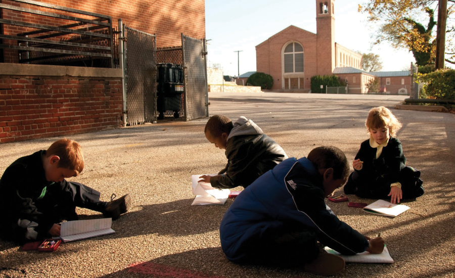 Students studying outside St. Jerome Academy.