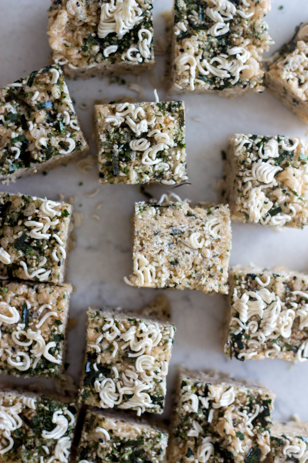 Ramen Furikake Rice Krispies - makes one 8x8 or 9x9-inch panadapted from joy the baker4 tablespoons unsalted butter, plus more for greasing pan1 10-ounce bag large marshmallows 5 cups Rice Krispies cereal2 packages instant ramen noodles (like top ramen), 3 oz eachabout 6 tablespoons furikake seasoning, divided