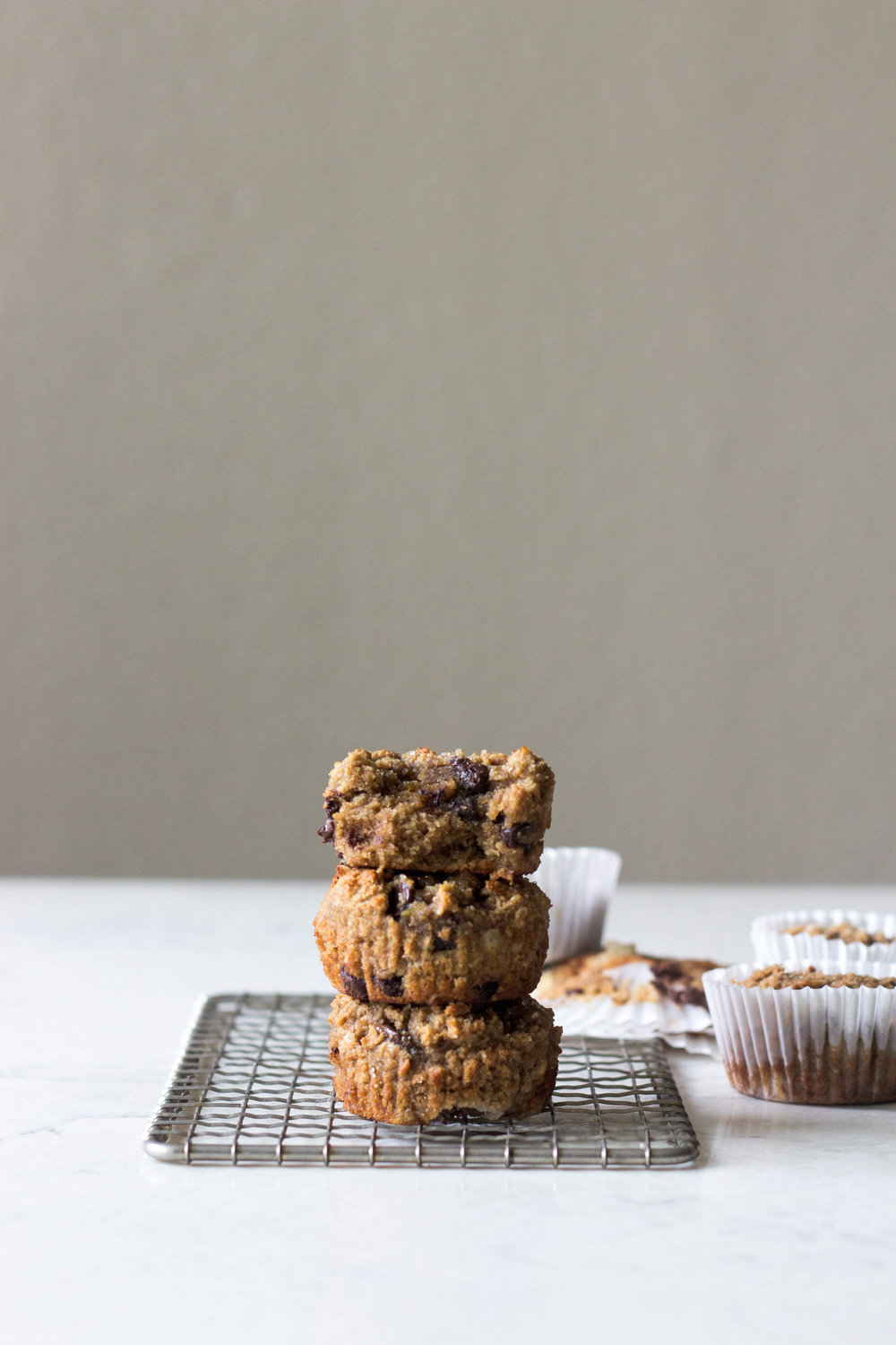 coffee banana oat almond muffins - makes about 10-12 muffinsadapted from Vanilla Bean Blog2 cups almond meal/flour1/2 cup rolled oats (gf oats if you want a gf muffin)1/4 teaspoon baking powder1/2 teaspoon salt1/4 cup flavorless oil1/4 cup honey1/4 cup coffee, cooled1 teaspoon vanilla1 egg1/2 teaspoon baking soda1 banana, mashed1/2 cup semi-sweet chocolate chips (optional)2 tablespoons cacao nibs (optional) turbinado sugar, for sprinkling (optional)