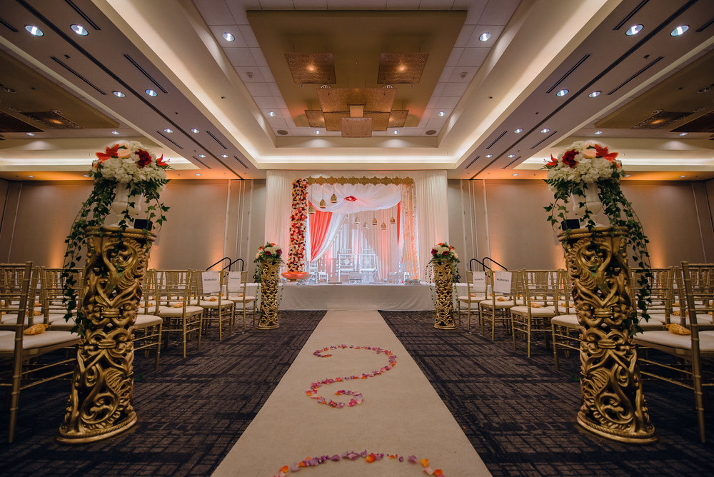 The Accent. - Using a fewer number of fixtures spread evenly over a larger area, we are able to achieve symmetrical accents and a soft glow to the room. We recommend this look for indoor ceremonies, intimate receptions, and rehearsal dinners.Photo Credit: Photographick