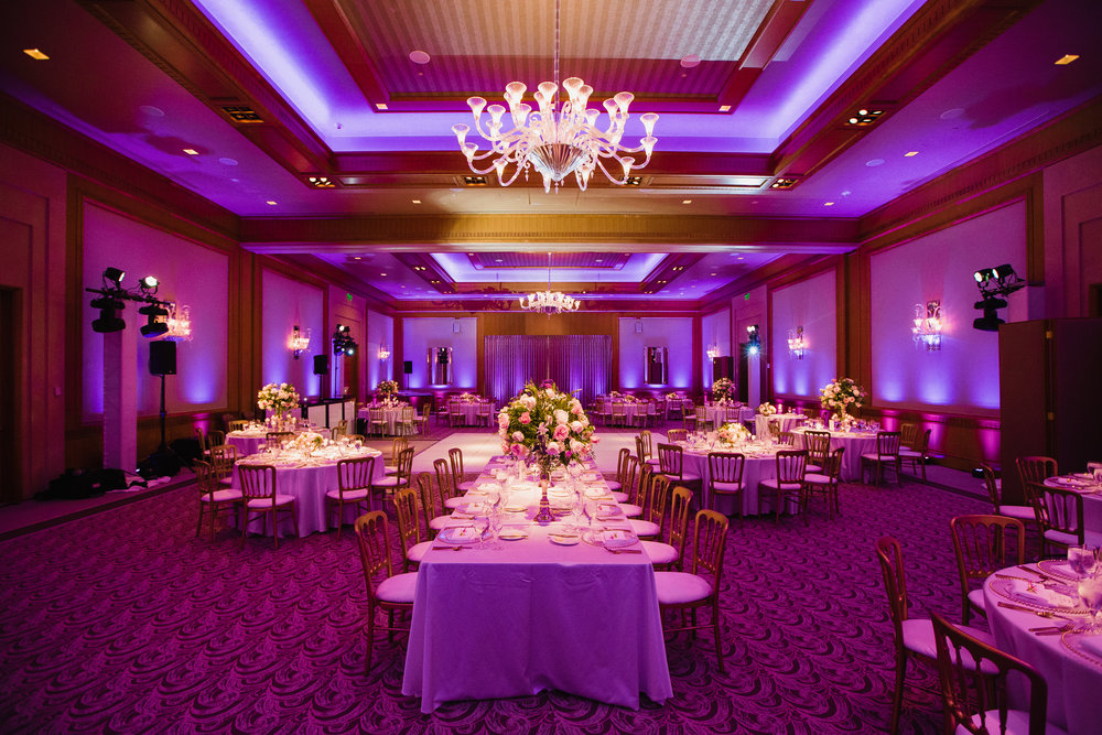 The Full Wash. - Using a larger quantity of fixtures placed closely together, we are able to reduce the physical space between lights, resulting in a continuous wash effect that looks simply stunning in photos and in person! We recommend this look for all midsize and large scale weddings, corporate events, and social functions.Photo Credit: Joe Payne Photography