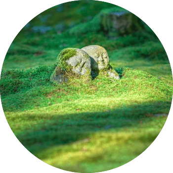 moss covered stone figurines