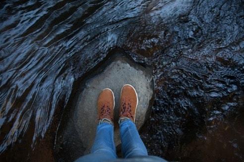 dried lava flow surrounding feet