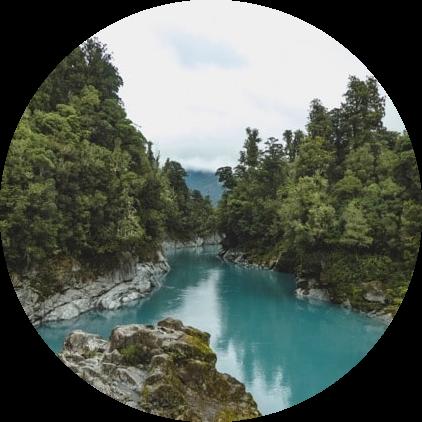 aqua blue river running through forest