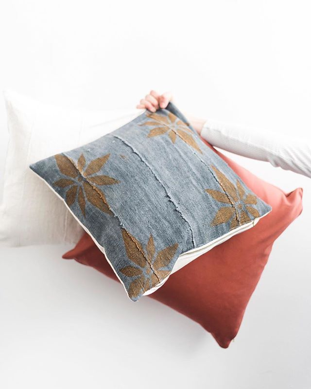 "This gold flower pillow is beautiful! The best way to describe it is ""moody but calming"". Kind of like the spring showers we're experiencing over here! We've got only 3 left of these in the shop! Can't wait to see how you style them!"