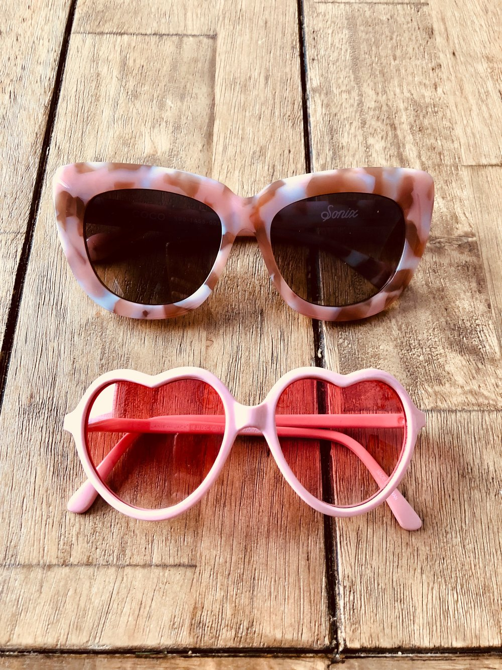 Heart shaped sunglasses  are Nina's, for the record. Top pink ones are no longer available at Anthropologie, but may be somewhere else. They are Sonix.