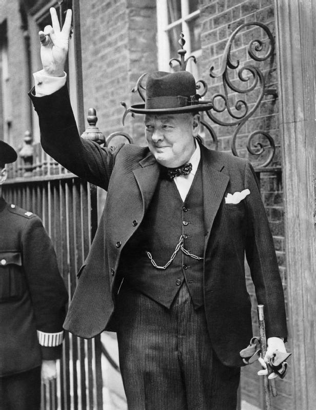 "Winston Churchill giving his famous ""V for victory"" sign"