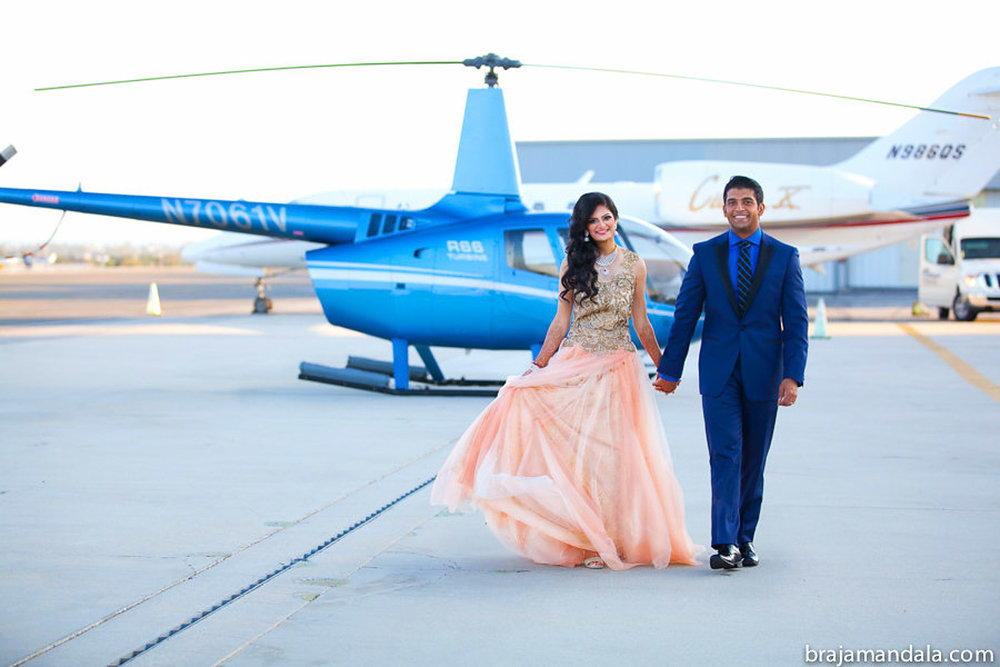 1 Album Cover - bride-and-groom-helicopter-entrance.jpg