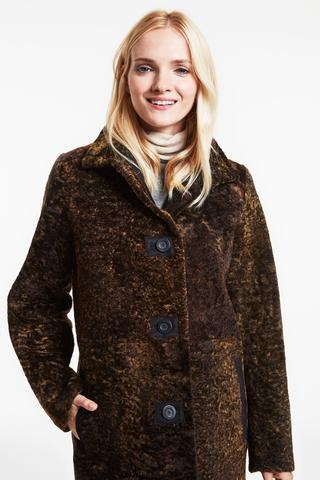 reversible astrakhan style shearling coat