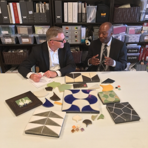 Designer Steve Howard listens to James Nigel discuss the process of hand-making tiles, at our design atelier in our Grand Rapids studio.