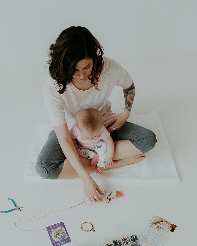 Hayley Loewen and her baby making custom mala beads