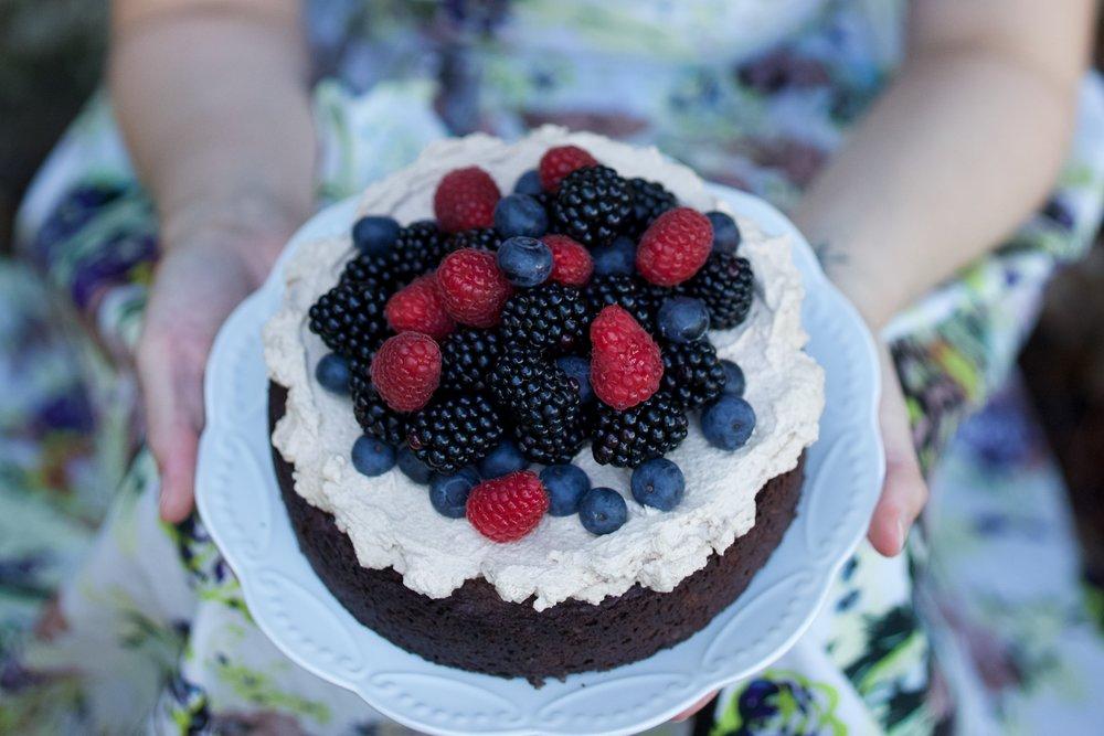 Vegan mud cake with mocha cream and berries
