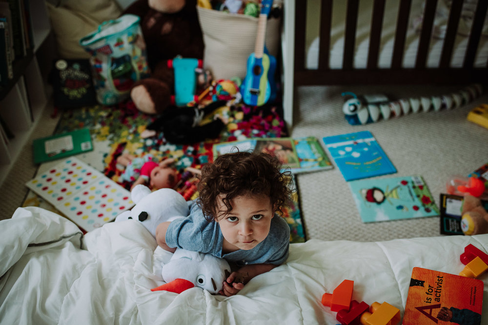 environmental portrait of a toddler with toys in washington dc
