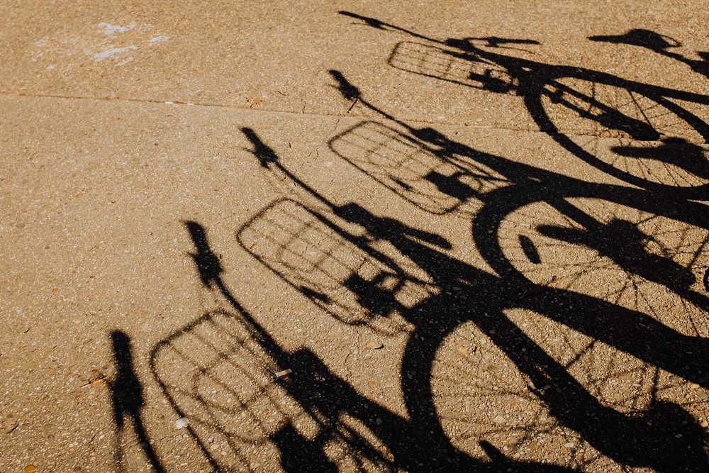bicycle shadows urban street photography district of columbia
