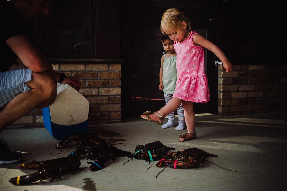 girl stomping on lobster granby massachusetts