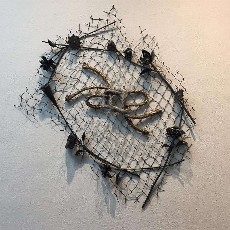 love lies (here)   cast bronze, forged steel, fish net, broken glass, gold