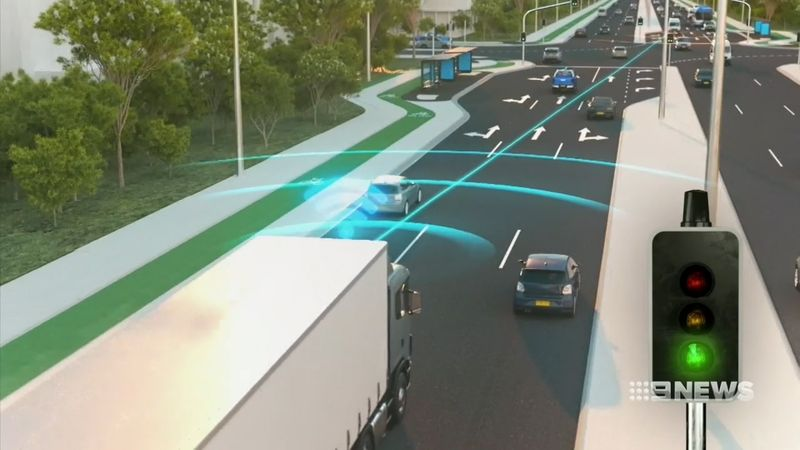 Trucks are being fitted with a device that communicates with traffic lights.