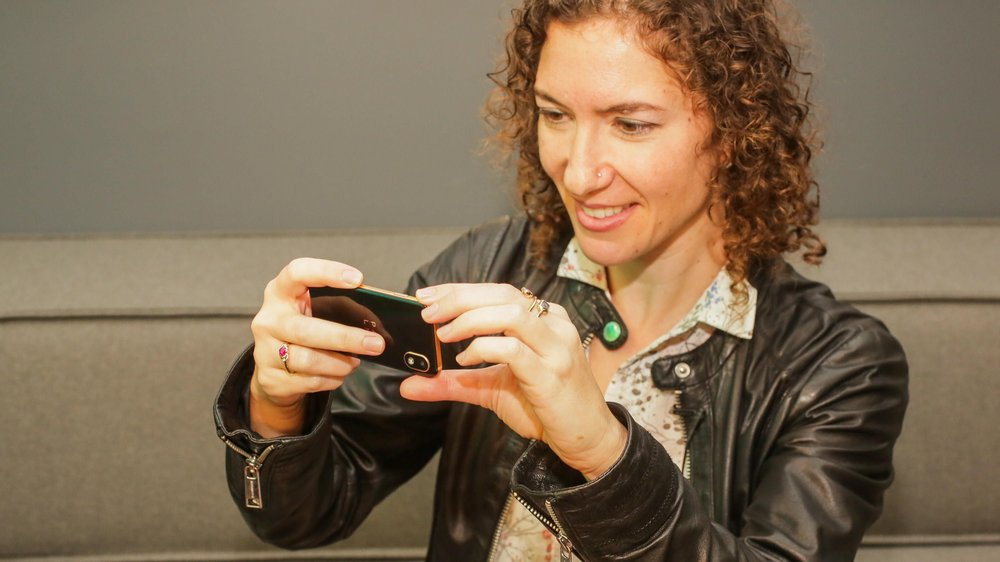 Yep, the Palm device takes photos too.  Sarah Tew/CNET