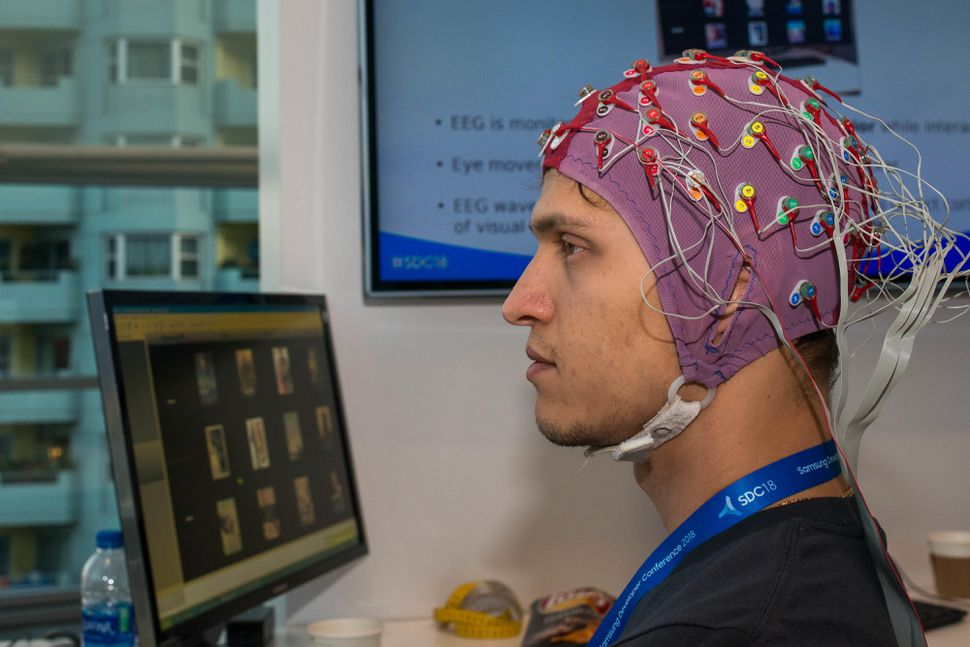 Samsung's Project Pontis collects brainwaves to decide if the user wants to select a particular movie.  Angela Lang/CNET