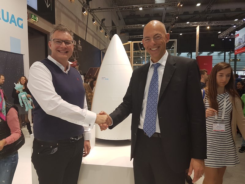 Holger Wentscher (right) and Stephen Bury (left), Chief Engineer of Gilmour Space, shaking hands upon the sound agreement between RUAG Space and Gilmour Space.