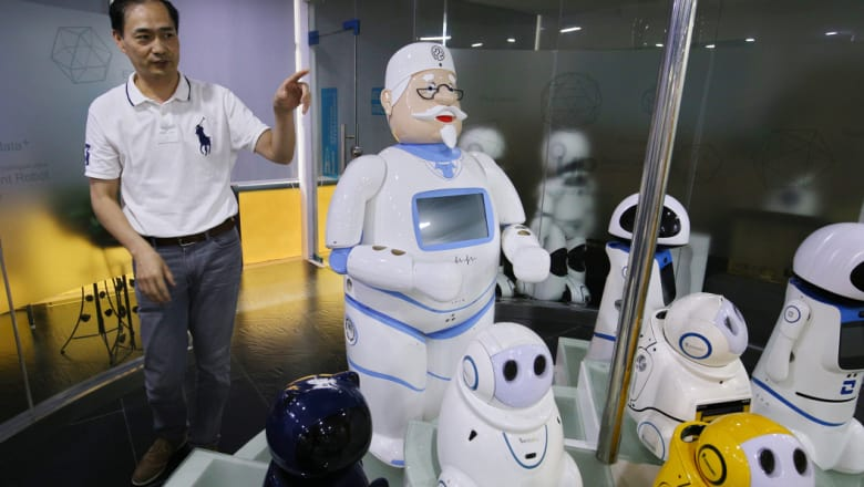 Simon Wang introduces Canbot's robot family to visitors at Canbot headquarters in Shenzhen. CREDIT: SANGHEE LIU