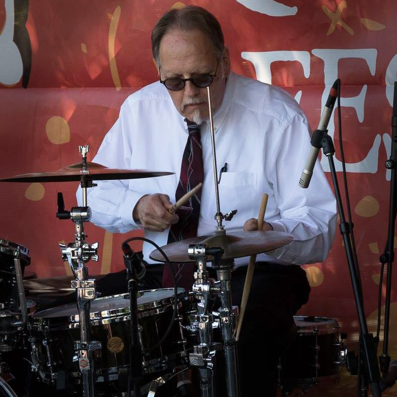 "Hal Smith - drums, leader - A full-time musician since 1978, Hal has played in nearly every Classic jazz band of note: the Dukes of Dixieland, Jim Cullum Jazz Band, Butch Thompson Trio, New Black Eagles, Fat Babies, Banu Gibson and led bands such as the Roadrunners, with Bobby Gordon and Rebecca Kilgore. Hal travels across the U.S. to work with bands including his own ""Swing Central"" and ""Pretty Wild."" In addition to his musical activities, Hal writes for America's Finest City Dixieland Jazz Society's JAZZ RAMBLER. He is a longtime fan of Kid Ory's drummer Minor Hall."