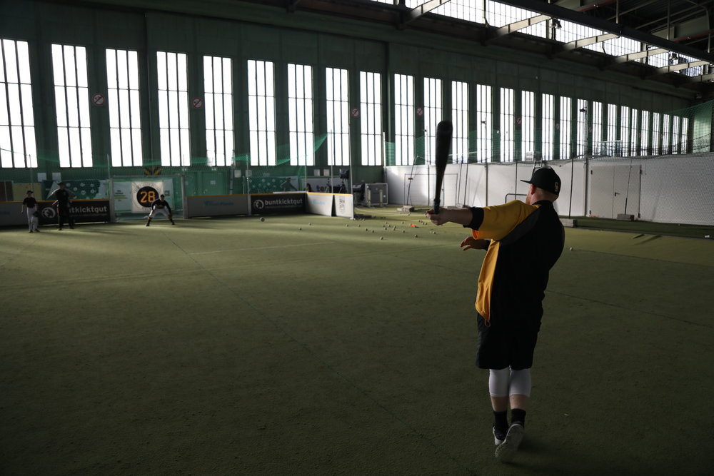 The Hangar - Inside the iconic WWII era airport located in the heart of Berlin, Germany we have an indoor baseball training center complete with an indoor infield, batting cage, and much much more. Through a dynamic partnership with Tentaya we have seen this dream become a reality