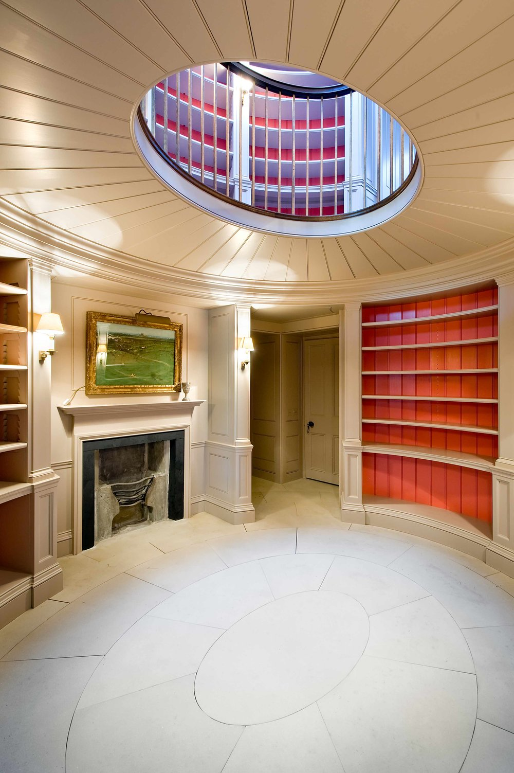 Elliptical fitted bookcase scheme spanning two floors, Edinburgh.