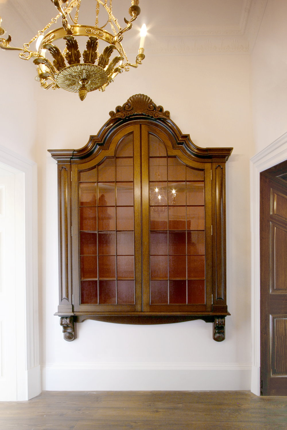 Eilean Aigas mahogany display cases one of three.
