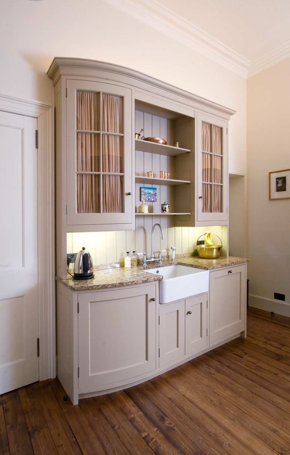 Painted kitchen with granite worktops and curved units, the Grange, Edinburgh.