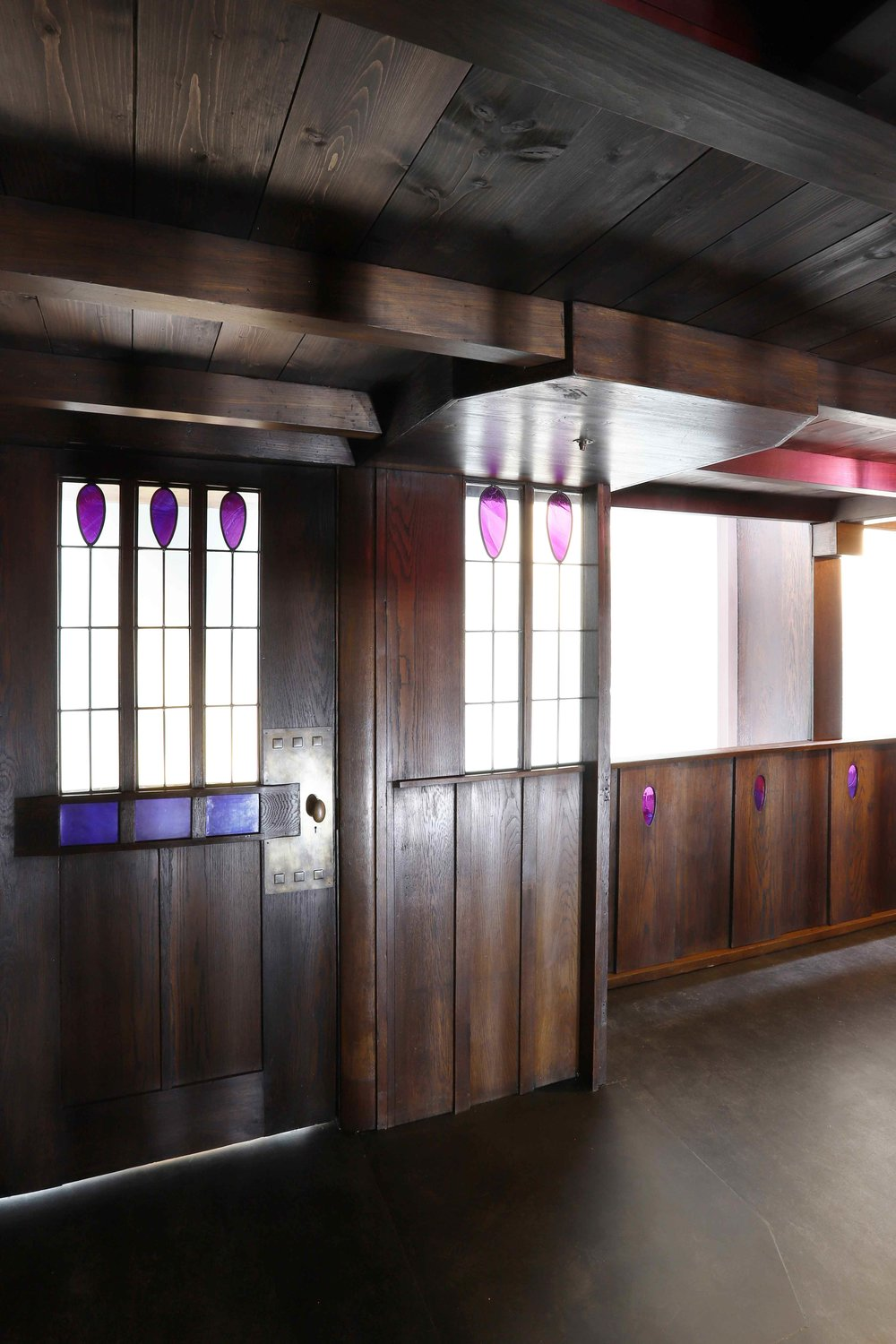 Conservation of The Oak Room, C R Mackintosh, replica stained glass elements, conserved glass and false windows, V&A Dundee.