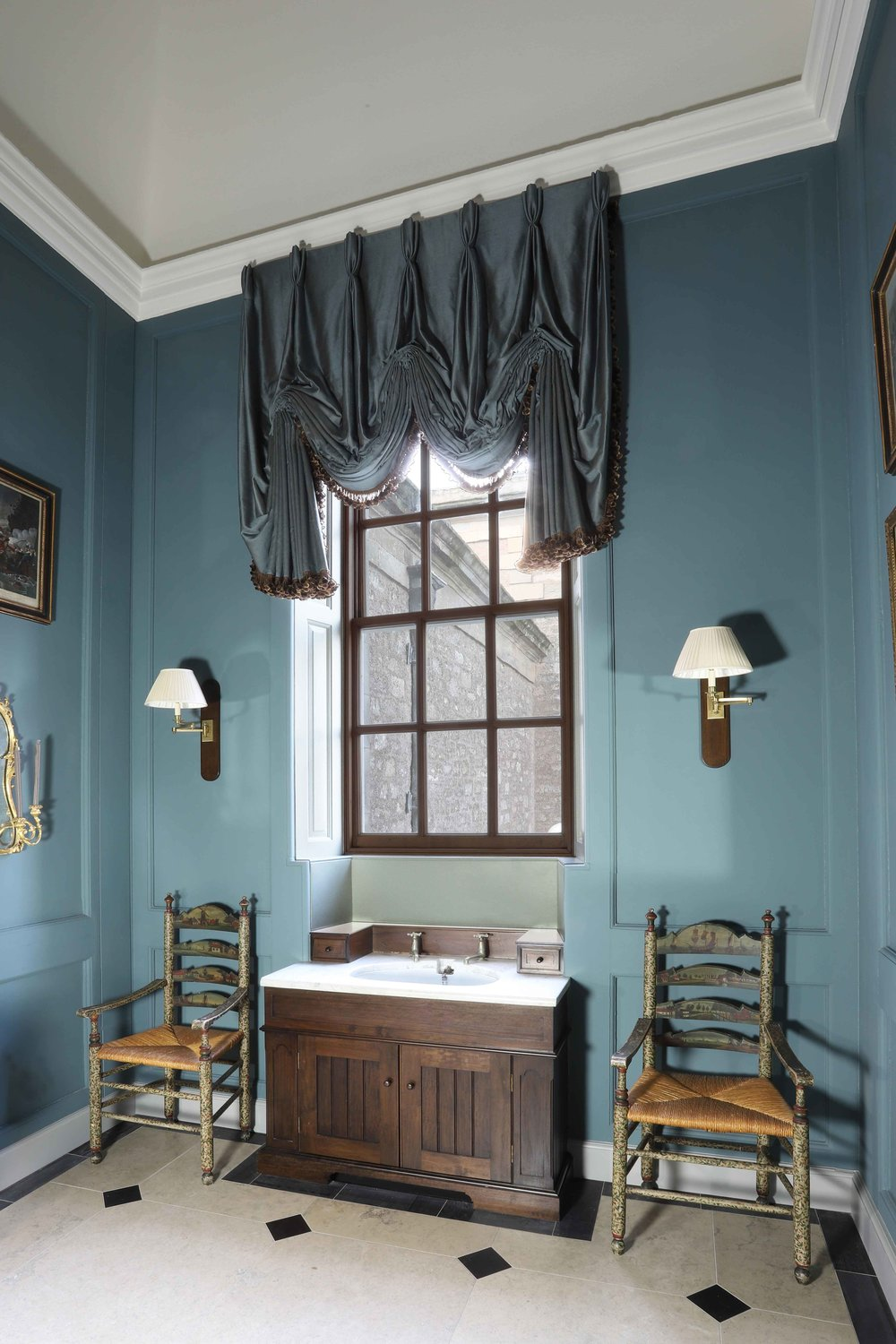 Sink unit in dark stained walnut with antique marble sink, Marchmont house.