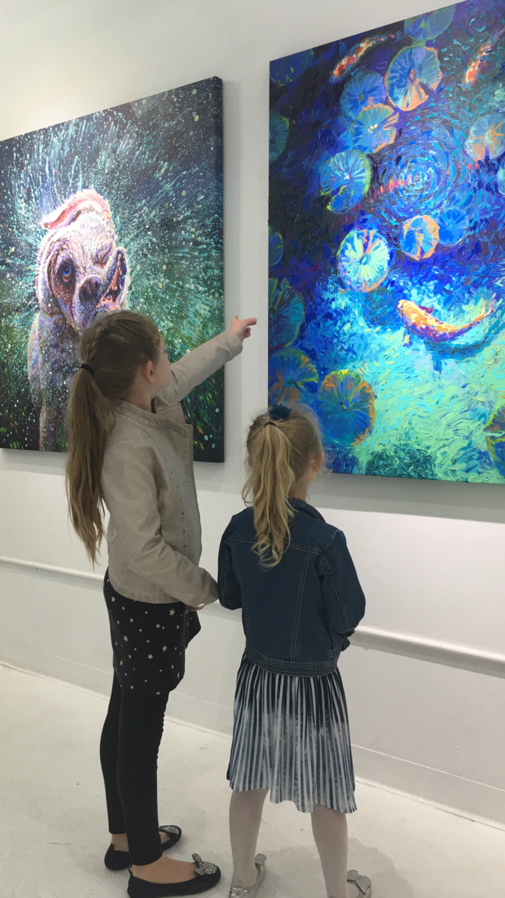Two young girls admiring the finger paint art by Iris Scott at Filo Sofi Arts NYC.png