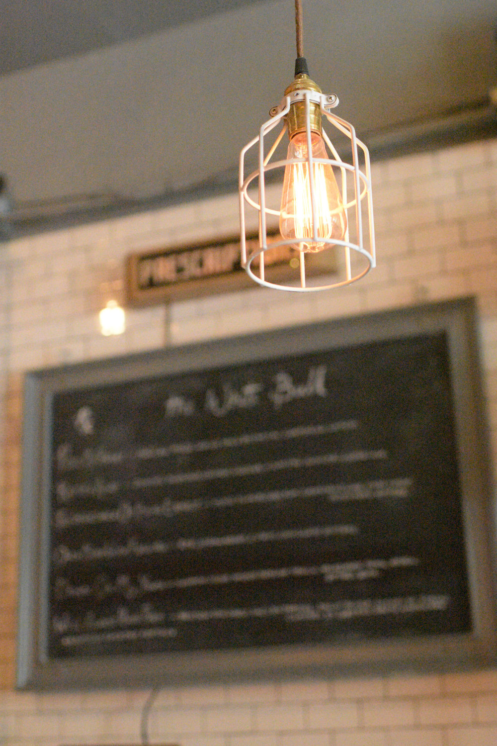 The White Bull's dining space is a pristine mix of exposed wood and industrial lighting, which gives the space an upscale and welcoming feel.