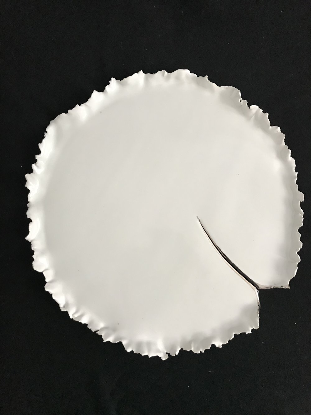 "How the Light Gets In (Victoria Lotus Leaf),  glazed porcelain with white gold on cracked area only, 1""H rim x 12.75""diameter, 2018  $325"