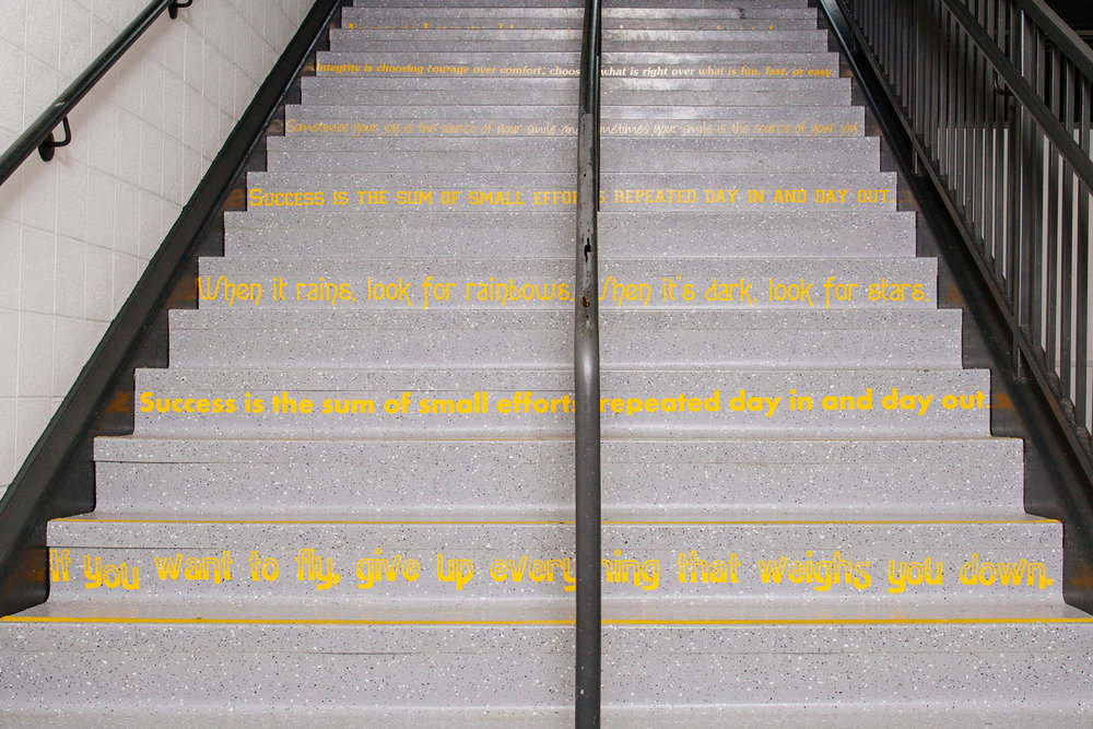 Motivational Quotes line the stairways