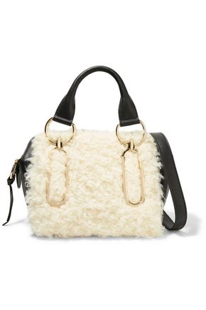 See By Chloé Small Shearling and Leather Shoulder Bag $238,  TheOutnet.com